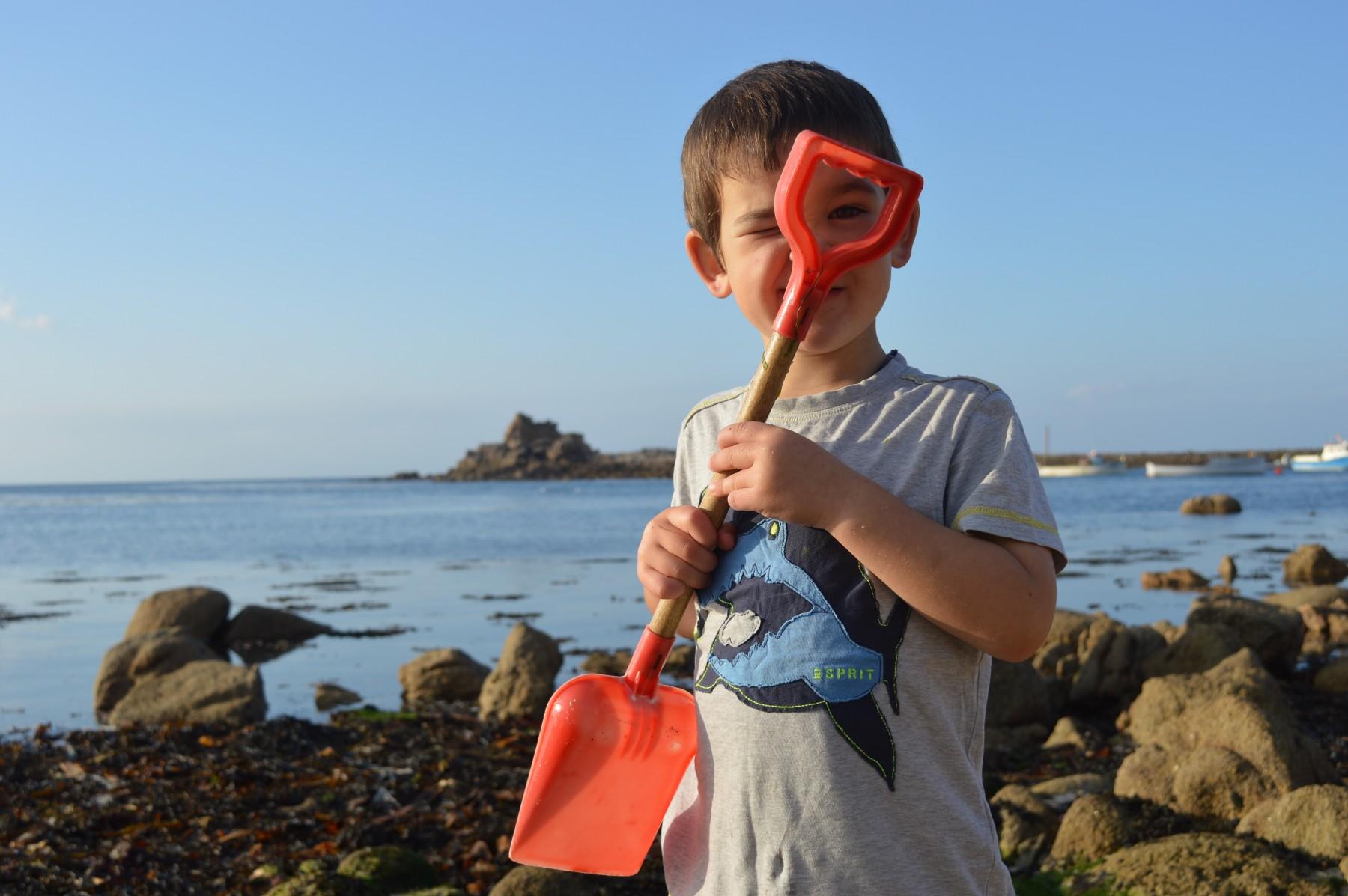 Little boy with spade