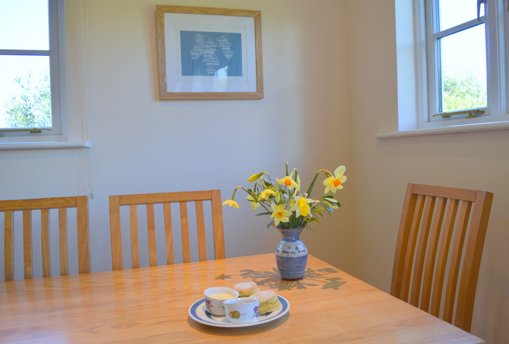 Dining table with flowers and cream tea